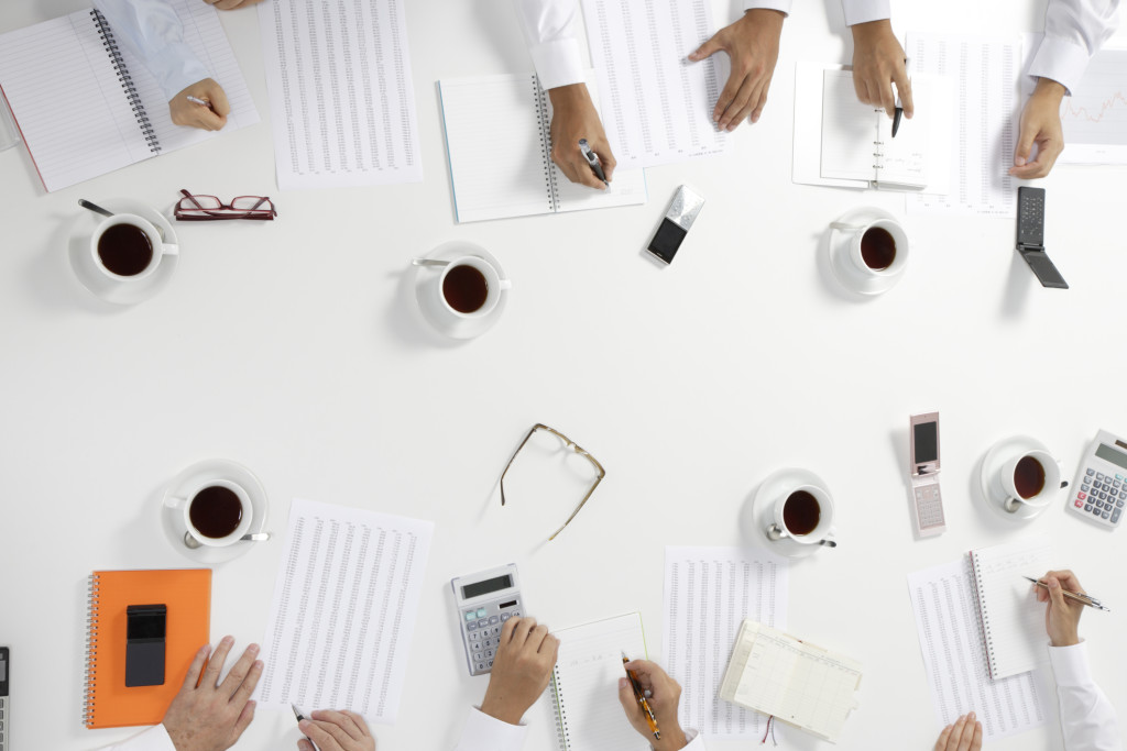 Business meeting at conference table, high angle view