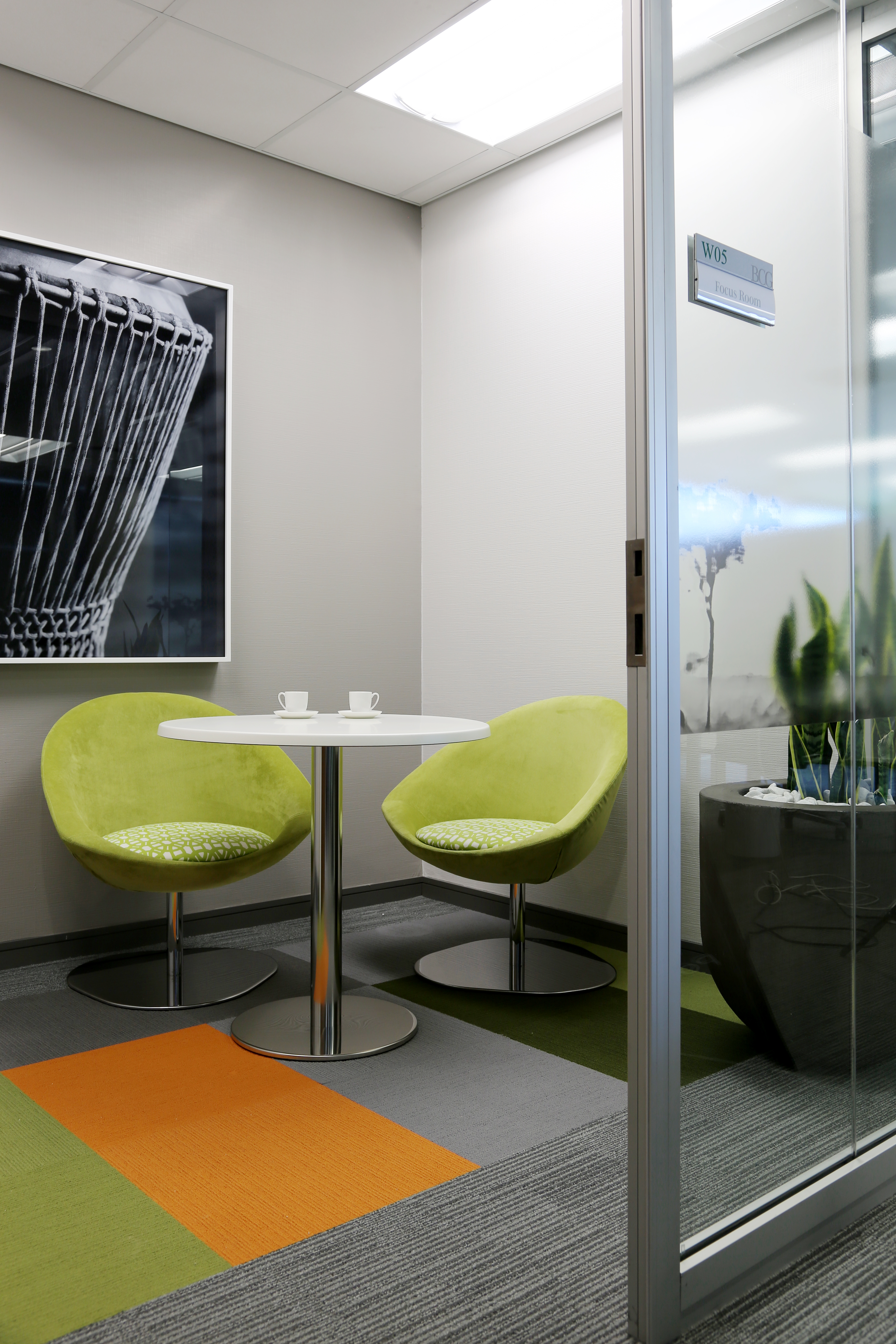A picture containing indoor, chair, floor, table Description generated with very high confidence