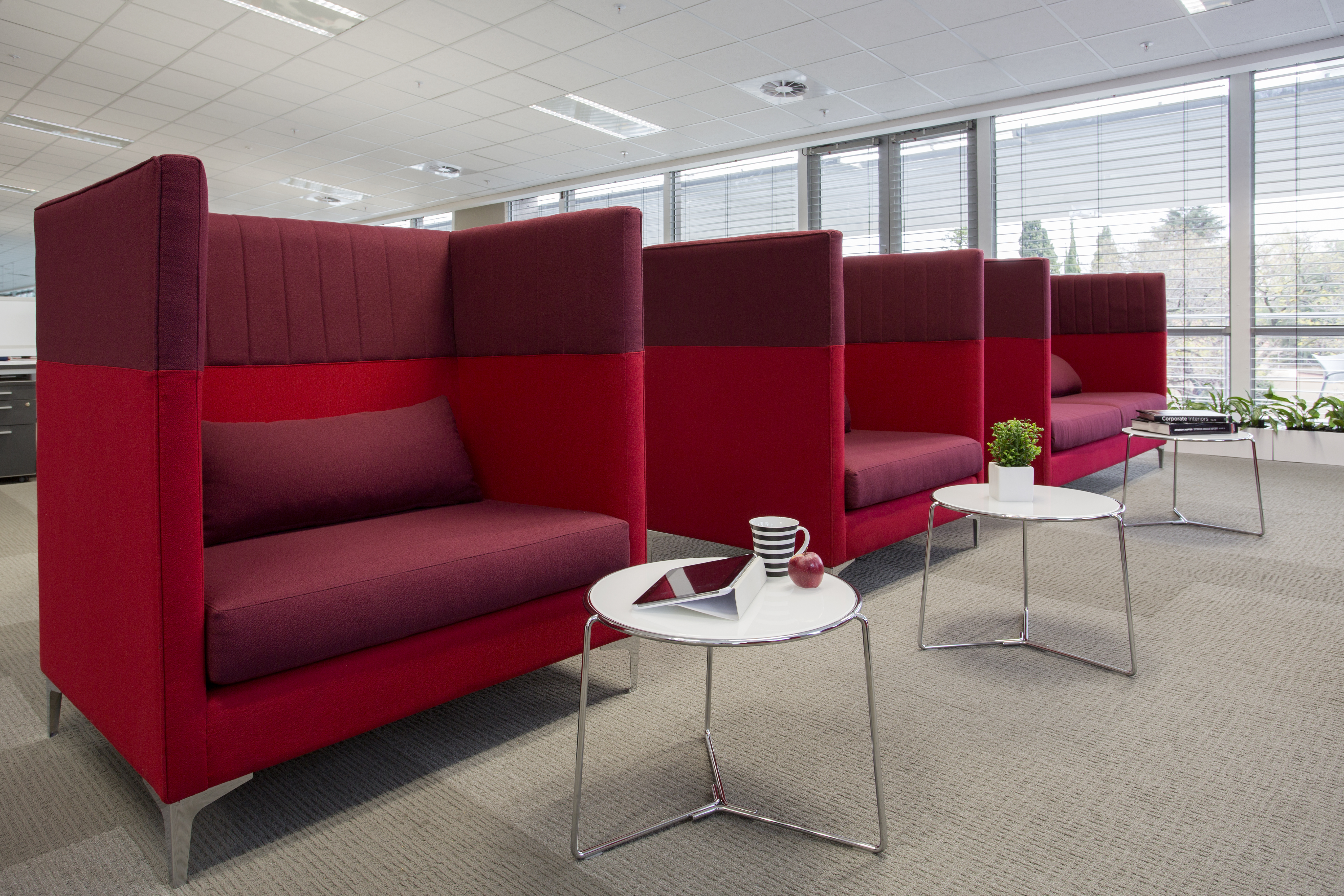 A large red chair in a room Description generated with very high confidence