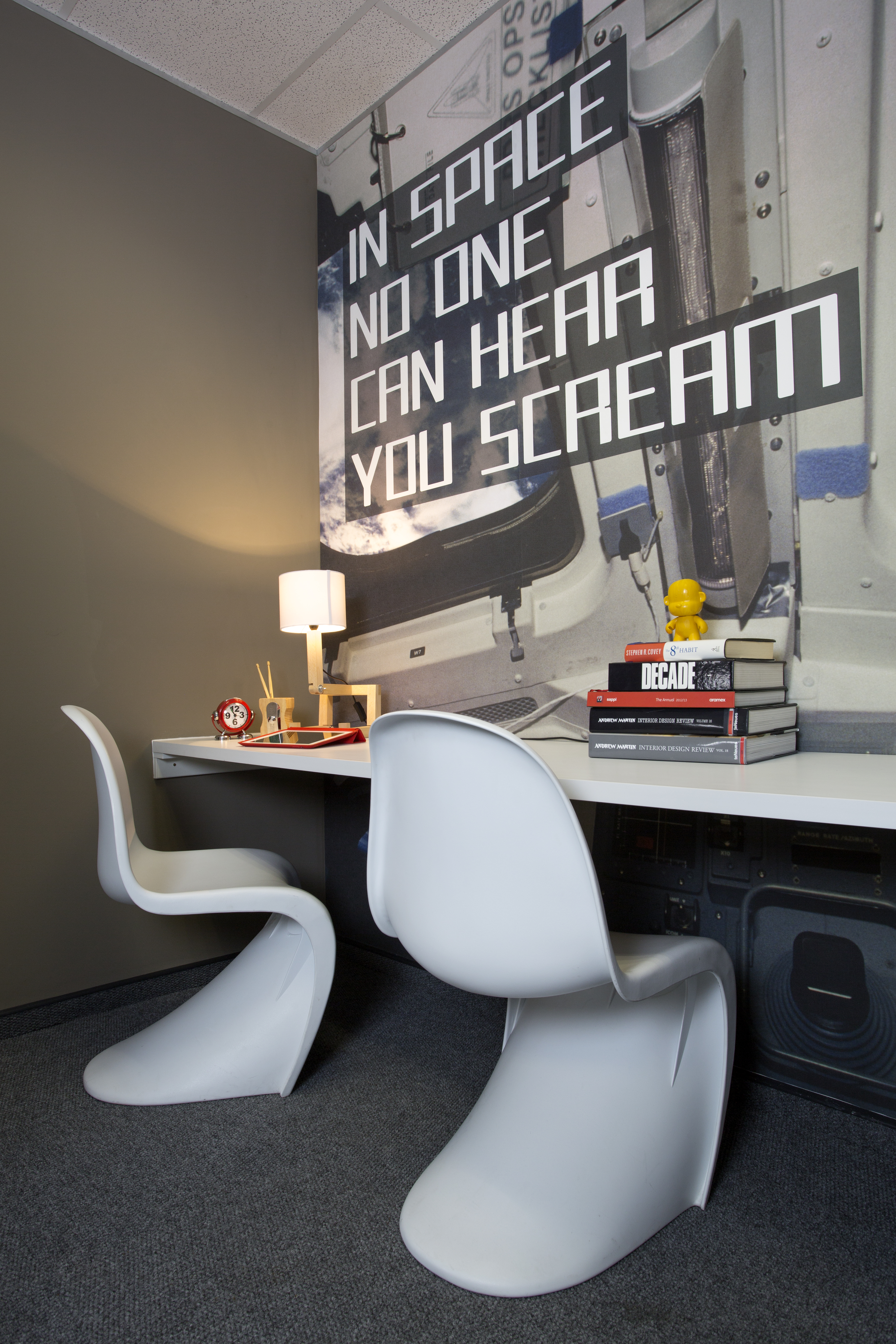 A desk with a computer in a room Description generated with high confidence